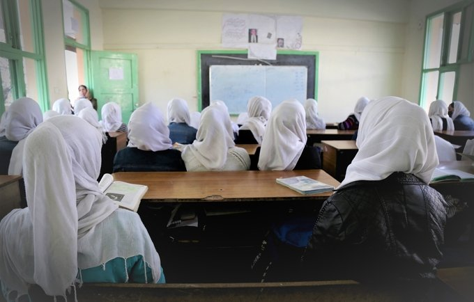 Female Classroom with Empty Desk when a Student was no longer Permitted to Continue Education once Married