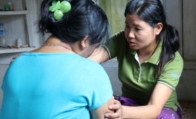 Lu Bu, a caseworker on gender-based violence in Myanmar, works with a survivor. Photo: UNFPA / Yenny Gamming.