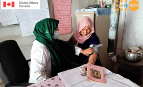 A midwife takes a woman's blood pressure at a family health house in rural Afghanistan. © UNFPA Afghanistan
